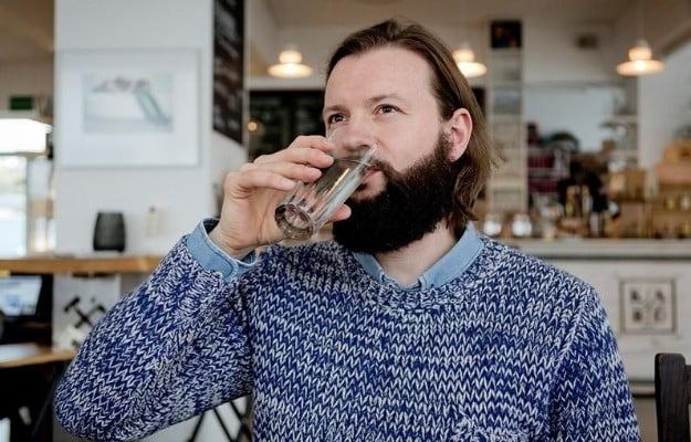 a man drinking water   Reasons why Intermittent Fasting is the Simplest Diet Ever   10 Reasons Why Intermittent Fasting Is The Simplest Diet Ever