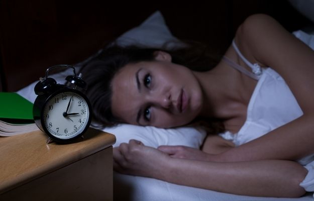 a woman cannot sleep next to a clock | Signs and Symptoms of Low Progesterone | Hormone Health: Signs of Low Progesterone